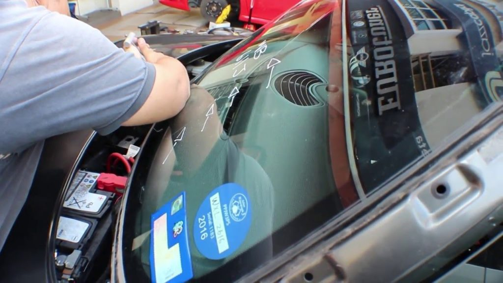 Fixing front windshield on toyota car